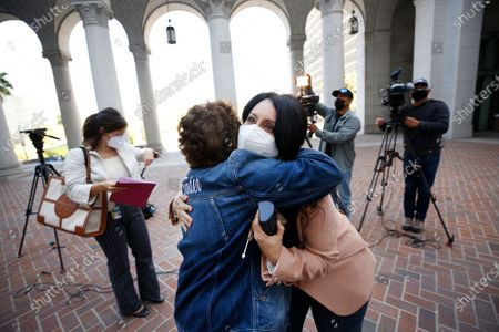 Los Angeles City Council President Nury Martinez hugs Patti Giggans, Denim Day founder and CEO of Peace Over Violence as local leaders wearing their jeans in solidarity with survivors of rape and sexual assault, gathered at Los Angeles City Hall to proclaim April 28th Denim Day in Los Angeles which was started by Giggans in 1999. The annual Denim Day education campaign began 22 years ago in Los Angeles. Now a worldwide movement, Denim Day invites people everywhere to wear their jeans in solidarity with survivors, and reminds everyone that there is no excuse and never an invitation to rape. The annual observance recalls an Italian Supreme Court case that sparked international outrage when a judge overturned a lower court's conviction of a rapist because the victim wore jeans. The judges ruled that because the victim was wearing tight jeans, she must have helped her attacker remove them, thus implying consent. Los Angeles City Hall on Wednesday, April 28, 2021 in Los Angeles, CA. (Al Seib / Los Angeles Times).