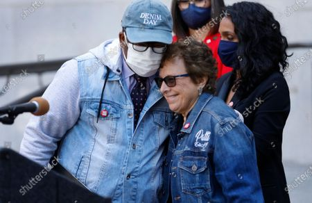 Wearing all denim Los Angeles Councilmember Mark Ridley-Thomas hugs Patti Giggans, Denim Day founder and CEO of Peace Over Violence as local leaders wearing their jeans in solidarity with survivors of rape and sexual assault, gathered at Los Angeles City Hall to proclaim April 28th Denim Day in Los Angeles which was started by Giggans in 1999. The annual Denim Day education campaign began 22 years ago in Los Angeles. Now a worldwide movement, Denim Day invites people everywhere to wear their jeans in solidarity with survivors, and reminds everyone that there is no excuse and never an invitation to rape. The annual observance recalls an Italian Supreme Court case that sparked international outrage when a judge overturned a lower court's conviction of a rapist because the victim wore jeans. The judges ruled that because the victim was wearing tight jeans, she must have helped her attacker remove them, thus implying consent. Los Angeles City Hall on Wednesday, April 28, 2021 in Los Angeles, CA. (Al Seib / Los Angeles Times).