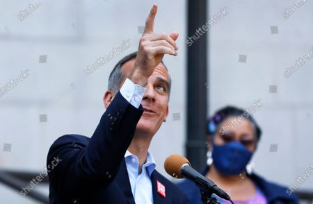 Los Angeles Mayor Eric Garcetti points to the Superior Court Building across the street from city hall referencing where his Father once worked as local leaders wearing their jeans in solidarity with survivors of rape and sexual assault, gathered at Los Angeles City Hall to proclaim April 28th Denim Day in Los Angeles which was started by Giggans in 1999. The annual Denim Day education campaign began 22 years ago in Los Angeles. Now a worldwide movement, Denim Day invites people everywhere to wear their jeans in solidarity with survivors, and reminds everyone that there is no excuse and never an invitation to rape. The annual observance recalls an Italian Supreme Court case that sparked international outrage when a judge overturned a lower court's conviction of a rapist because the victim wore jeans. The judges ruled that because the victim was wearing tight jeans, she must have helped her attacker remove them, thus implying consent. Los Angeles City Hall on Wednesday, April 28, 2021 in Los Angeles, CA. (Al Seib / Los Angeles Times).