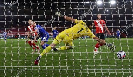 Jonny Evans (2-L) of Leicester scores his team's opening goal during the English Premier League soccer match between Southampton FC and Leicester City in Southampton, Britain, 30 April 2021.