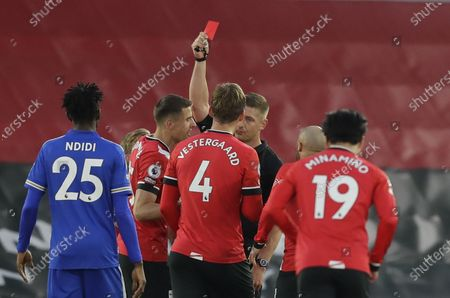 Stock Image of Jannik Vestergaard (L) of Southampton is shown a red card by referee Robert Jones during the English Premier League soccer match between Southampton FC and Leicester City in Southampton, Britain, 30 April 2021.