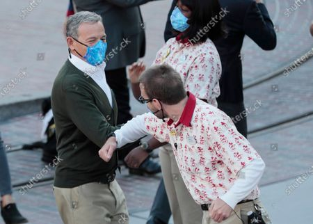 Stock Picture of Disneyland CEO Bob Iger elbow bumps a cast member as the theme park gets ready to receive guest for the first time in more than a year on Friday, April 30, 2021. (Robert Gauthier / Los Angeles Times)