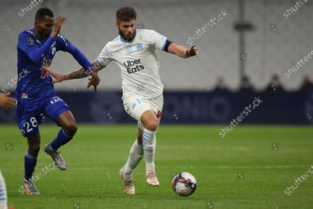 Marseille's Duje Caleta-Car, right, is challenged by Strasbourg's Habib Diallo during the French League One soccer match between Marseille and Strasbourg at the Stade Veledrome stadium in Marseille, France