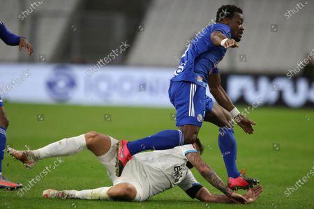 Stock Image of Strasbourg's Lamine Kone, right, steps on Marseille's Duje Caleta-Car's hand during the French League One soccer match between Marseille and Strasbourg at the Stade Veledrome stadium in Marseille, France