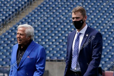 Stock Photo of New England Patriots 2021 first-round draft pick, former Alabama quarterback Mac Jones, right, walks with team owner Robert Kraft, left, in Foxborough, Mass. The Patriots selected Jones with the 15th pick in Thursday's NFL Draft