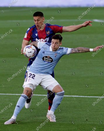 Celta Vigo's striker Santi Mina (R) vies for the ball with Levante's defender Oscar Duarte (L) during the Spanish LaLiga soccer match between Celta Vigo and Levante UD held at Balaidos stadium, in Vigo, northern Spain, 30 April 2021.