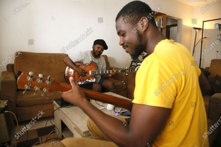 Constant Boty (L), Ivorian guitarist, composer and educator plays guitar at his home one day before the International Djazz Day in Abidjan, Ivory Coast, 29 April 2021. Constant Boty of Ivorian origin is a virtuoso of Jazz music. Author, composer, performer, arranger, producer and teacher, he is equally aimed at aficionados of jazz, rock and world music. His first album 'Guru Guru' released in 2015, was followed by several singles including: Shine On (dedicated to Kofi Annan), 'Time To Care'.