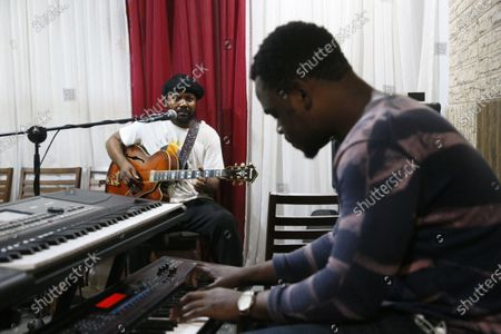 Constant Boty (L), Ivorian guitarist, composer and educator performs during a rehearsal in a recording studio two days before the International Djazz Day in Abidjan, Ivory Coast, 28 April 2021. Constant Boty of Ivorian origin is a virtuoso of Jazz music. Author, composer, performer, arranger, producer and teacher, he is equally aimed at aficionados of jazz, rock and world music. His first album 'Guru Guru' released in 2015, was followed by several singles including: Shine On (dedicated to Kofi Annan), 'Time To Care'.