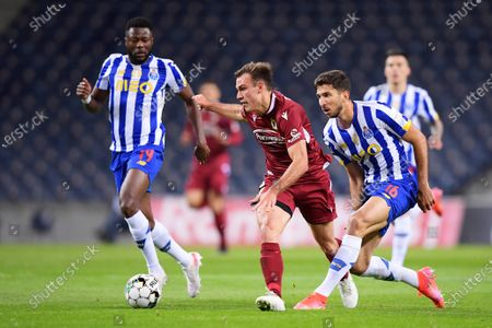 Stock Image of Marko Grujic of FC Porto beaten by the pace of Manuel Ugarte of Famalicao