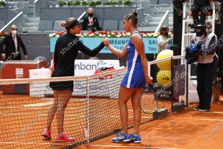 "(L-R) Simona Halep (ROU), Sara Sorribes Tormo (ESP) - Tennis : Simona Halep of Romania and Sara Sorribes Tormo Singles 1st round match on the WTA 1000 ""Mutua Madrid Open tennis tournament"" at the Caja Magica in Madrid, Spain."