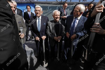 Stock Image of LOS ANGELES, CA - FEBRUARY 11, 2019 - - With shovels in hand, philanthropist Eli Broad, second from left, architect Frank Gehry, center, and Kenneth Himmel, president and chief executive officer of Related Urban, next to Gehry, prepare to break ground for The Grand in front of the Walt Disney Concert Hall in downtown Los Angeles on February 11, 2019. Construction on the $1 billion Grand Avenue Project is set to begin. The complex of condominiums, apartments, shops, restaurants and a hotel has been delayed several times since 2004, when Related Companies was selected by city and county officials to transform land. (Genaro Molina/Los Angeles Times)