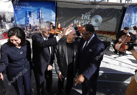 LOS ANGELES, CA - FEBRUARY 11, 2019 - - Los Angeles Board of Supervisors Hilda Solis, left, and Mark Ridley Thomas, enjoy a light moment with philanthropist Eli Broad, second from left, and architect Frank Gehry, while attending the groundbreaking ceremony for The Grand in front of the Walt Disney Concert Hall in downtown Los Angeles on February 11, 2019. Construction on the $1 billion Grand Avenue Project is set to begin. The complex of condominiums, apartments, shops, restaurants and a hotel has been delayed several times since 2004, when Related Companies was selected by city and county officials to transform land. (Genaro Molina/Los Angeles Times)