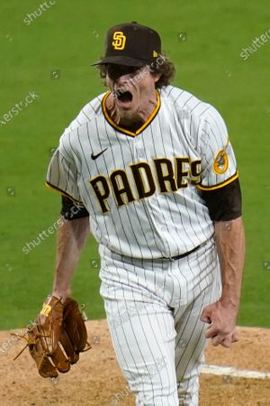 Stock Photo of San Diego Padres relief pitcher Tim Hill reacts after striking out San Francisco Giants' Mike Tauchman during the seventh inning of a baseball game, in San Diego