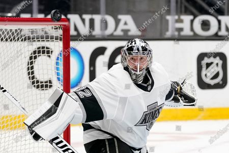 Los Angeles Kings goaltender Jonathan Quick deflects a shot during the second period of an NHL hockey game against the Anaheim Ducks, in Anaheim, Calif