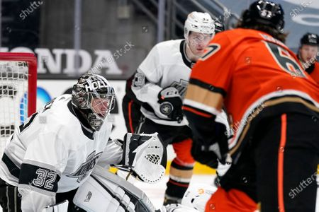 Anaheim Ducks center Rickard Rakell, right,tries to score on Los Angeles Kings goaltender Jonathan Quick during the second period of an NHL hockey game, in Anaheim, Calif