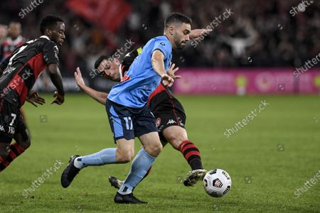 Stock Image of Anthony Caceres of Sydney goes past Bruce Kamau and Graham Dorrans of Western Sydney Wanderers; Bankwest Stadium, Parramatta, New South Wales, Australia; A League Football, Western Sydney Wanderers versus Sydney FC.