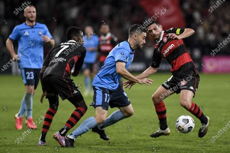 Anthony Caceres of Sydney goes between Bruce Kamau and Graham Dorrans of Western Sydney Wanderers; Bankwest Stadium, Parramatta, New South Wales, Australia; A League Football, Western Sydney Wanderers versus Sydney FC.