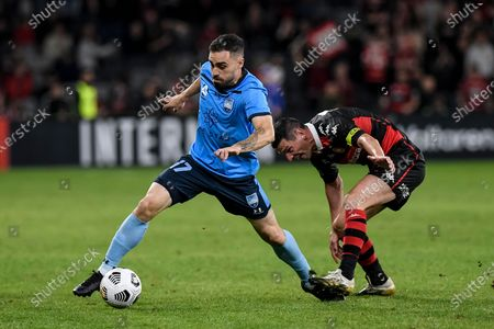 Anthony Caceres of Sydney goes past Graham Dorrans of Western Sydney Wanderers; Bankwest Stadium, Parramatta, New South Wales, Australia; A League Football, Western Sydney Wanderers versus Sydney FC.