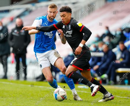 Stock Image of Morgan Rogers of Lincoln City takes on Mark Beevers of Peterborough United; Weston Homes Stadium, Peterborough, Cambridgeshire, England; English Football League One Football, Peterborough United versus Lincoln City.