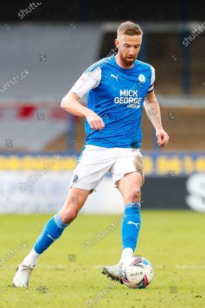 Mark Beevers of Peterborough United on the ball; Weston Homes Stadium, Peterborough, Cambridgeshire, England; English Football League One Football, Peterborough United versus Lincoln City.