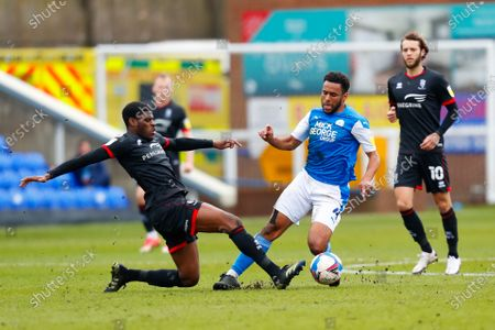TJ Eyoma of Lincoln City slides in and fouls Nathan Thompson of Peterborough United; Weston Homes Stadium, Peterborough, Cambridgeshire, England; English Football League One Football, Peterborough United versus Lincoln City.
