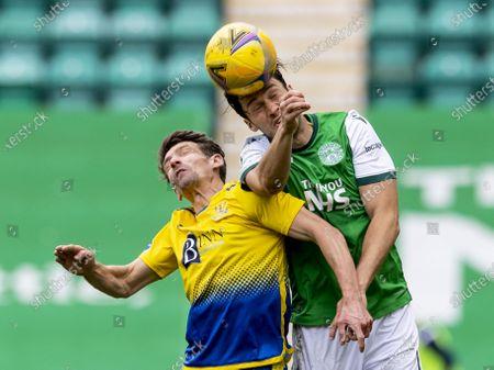 Stock Photo of Joe Newell of Hibernian wins header with Craig Bryson of St Johnstone; Easter Road, Edinburgh, Scotland; Scottish Premiership Football, Hibernian versus St Johnstone.