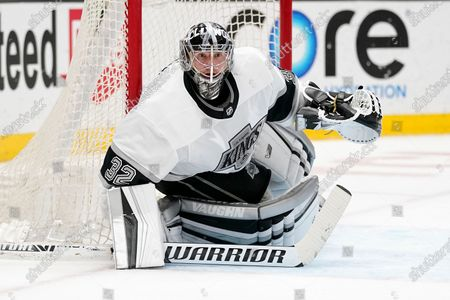 Los Angeles Kings goaltender Jonathan Quick sits in goal during the second period of an NHL hockey game against the Anaheim Ducks, in Anaheim, Calif