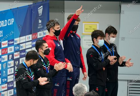 (L-R) - Silver medallists Randal Willars Valdez and Ivan Garcia Navarro of Mexico, gold medallist Thomas Daley and Matthew Lee of Britain and bronze medallists Vincent Riendeau and Nathan Zsombor-Murray of Canada celebrate one the podium after the men's synchronized 10m platform of the FINA Diving World Cup 2021 at Tokyo Aquatics Center in Tokyo, 01 May 2021.