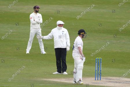 Umpire Neil Mallender checks with colleague Peter Hartley as he calls Tom Bailey of Lancashire for a no ball after the bowler had delivered an inadvertent beamer at Delray Rawlins  during the LV= Insurance County Championship match between Sussex County Cricket Club and Lancashire County Cricket Club at the 1st Central County Ground, Hove