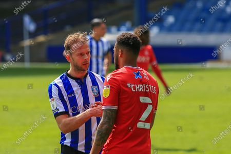 Jordan Rhodes (20) of Sheffield Wednesday  and Cyrus Christie (2) of Nottingham Forest after the final whistle during the EFL Sky Bet Championship match between Sheffield Wednesday and Nottingham Forest at Hillsborough, Sheffield