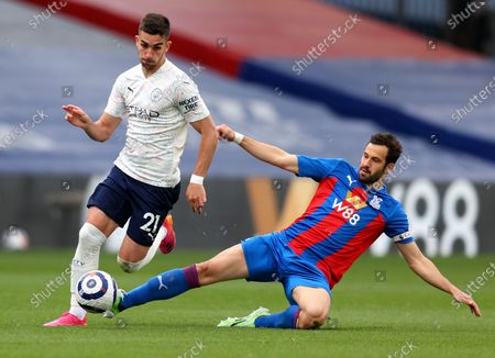 Manchester City's Ferran Torres is tackled by Crystal Palace's Luka Milivojevic, right, during the English Premier League soccer match between Crystal Palace and Manchester City at Selhurst Park in London, England
