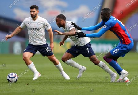 Stock Picture of Manchester City's Raheem Sterling, centre, and teammate Sergio Aguero, left, compete to keep the ball away from Crystal Palace's Cheikhou Kouyate, right, during the English Premier League soccer match between Crystal Palace and Manchester City at Selhurst Park in London, England