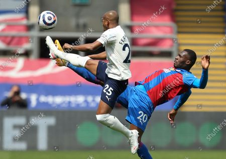 Manchester City's Fernandinho, left, and Crystal Palace's Christian Benteke battle for the ball during the English Premier League soccer match between Crystal Palace and Manchester City at Selhurst Park in London, England