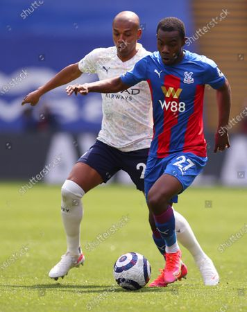 Crystal Palace's Tyrick Mitchell, right, battles for the ball with Manchester City's Fernandinho during the English Premier League soccer match between Crystal Palace and Manchester City at Selhurst Park in London, England