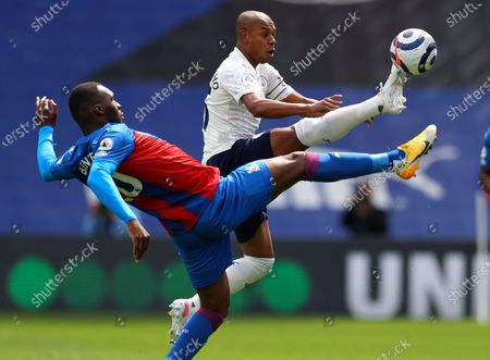 Manchester City's Fernandinho, right, and Crystal Palace's Christian Benteke battle for the ball during the English Premier League soccer match between Crystal Palace and Manchester City at Selhurst Park in London, England