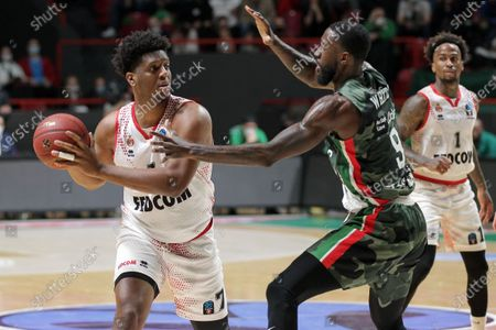 Stock Image of Damien Inglis (L) and Dee Bost (R) of AS Monaco in action against Okaro White (C)  of UNICS Kazan during the 7DAYS EuroCup basketball finals game 2 between UNICS Kazan and  AS Monaco in Kazan, Russia on April 30, 2021.
