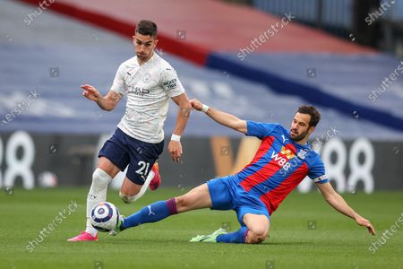 Luka Milivojevic (R) of Crystal Palace tackles Ferran Torres (R) of Manchester City during the English Premier League soccer match between Crystal Palace and Manchester City in London, Britain, 01 May 2021.