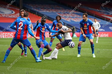 Cheikhou Kouyate (C-L) of Crystal Palace blocks an attempt from Raheem Sterling (C-R) of Manchester City during the English Premier League soccer match between Crystal Palace and Manchester City in London, Britain, 01 May 2021.