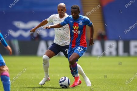 Tyrick Mitchell (R) of Crystal Palace in action against Fernandinho (L) of Manchester City during the English Premier League soccer match between Crystal Palace and Manchester City in London, Britain, 01 May 2021.