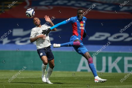 Stock Image of Cheikhou Kouyate (R) of Crystal Palace in action against Raheem Sterling (L) of Manchester City during the English Premier League soccer match between Crystal Palace and Manchester City in London, Britain, 01 May 2021.