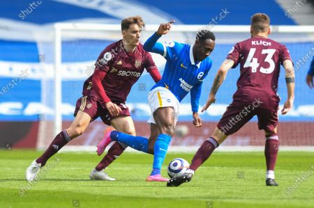 Leeds United defender Diego Llorente (14) and Brighton and Hove Albion forward Danny Welbeck (18) during the Premier League match between Brighton and Hove Albion and Leeds United at the American Express Community Stadium, Brighton and Hove