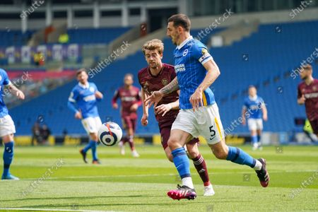 Leeds United forward Patrick Bamford (9) and Brighton and Hove Albion defender Lewis Dunk (5) during the Premier League match between Brighton and Hove Albion and Leeds United at the American Express Community Stadium, Brighton and Hove