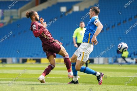 Leeds United forward Tyler Roberts (11) tackles Brighton and Hove Albion defender Lewis Dunk (5) during the Premier League match between Brighton and Hove Albion and Leeds United at the American Express Community Stadium, Brighton and Hove