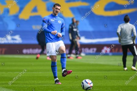 Brighton and Hove Albion defender Lewis Dunk (5) warming up at the Premier League match between Brighton and Hove Albion and Leeds United at the American Express Community Stadium, Brighton and Hove