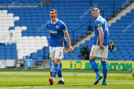 Brighton and Hove Albion defender Lewis Dunk (5) gestures and reacts towards the linesman at the Premier League match between Brighton and Hove Albion and Leeds United at the American Express Community Stadium, Brighton and Hove
