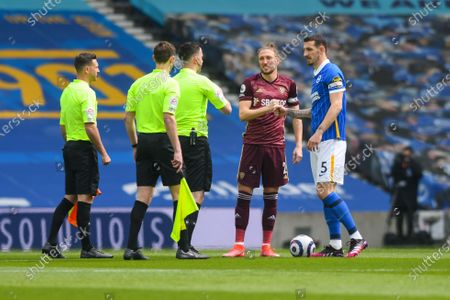 Leeds United defender Luke Ayling (2) greets Brighton and Hove Albion defender Lewis Dunk (5) pre-kickoff during the Premier League match between Brighton and Hove Albion and Leeds United at the American Express Community Stadium, Brighton and Hove