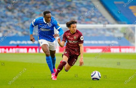 Leeds United midfielder Ian Poveda (7) gets away from Brighton and Hove Albion striker Danny Welbeck (18)  during the Premier League match between Brighton and Hove Albion and Leeds United at the American Express Community Stadium, Brighton and Hove