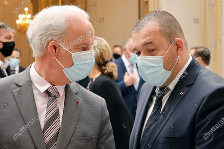 French Junior Minister of Small and Medium Entreprises Alain Griset (L) and French President's gastronomy advisor Guillaume Gomez take part in the traditional Lily of the valley ceremony at the Elysee palace, in Paris, France, 01 May 2021.