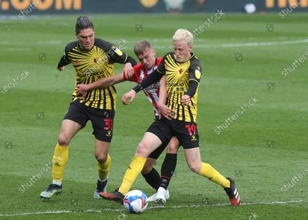 Stock Image of Will Hughes of Watford tries to shake of a challenge from Brentford's Marcus Forss during Brentford vs Watford, Sky Bet EFL Championship Football at the Brentford Community Stadium on 1st May 2021