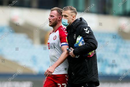 Daniel Bentley consoles a dejected Bristol City captain Tomas Kalas after Millwall win 4-1